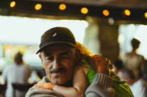 Image of grandfather holding young granddaughter to represent Fathers Day