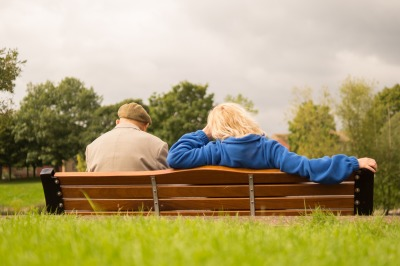 Image of couple resting on the bench to represent the 8 hours of rest that should occur on Labour Day