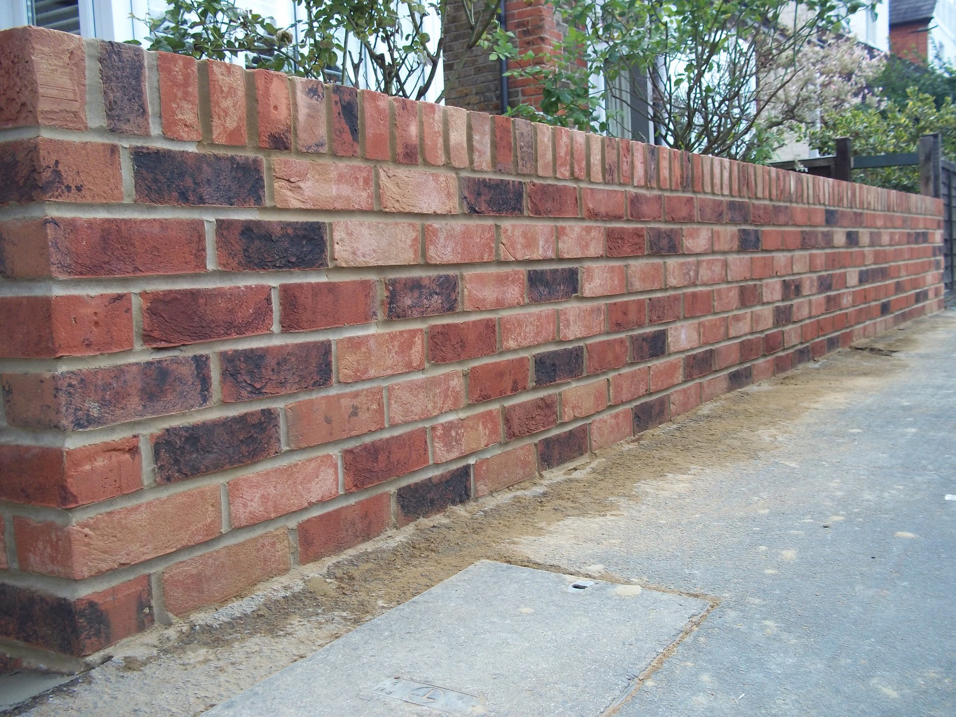"9"" garden wall capped off with brick on edge."