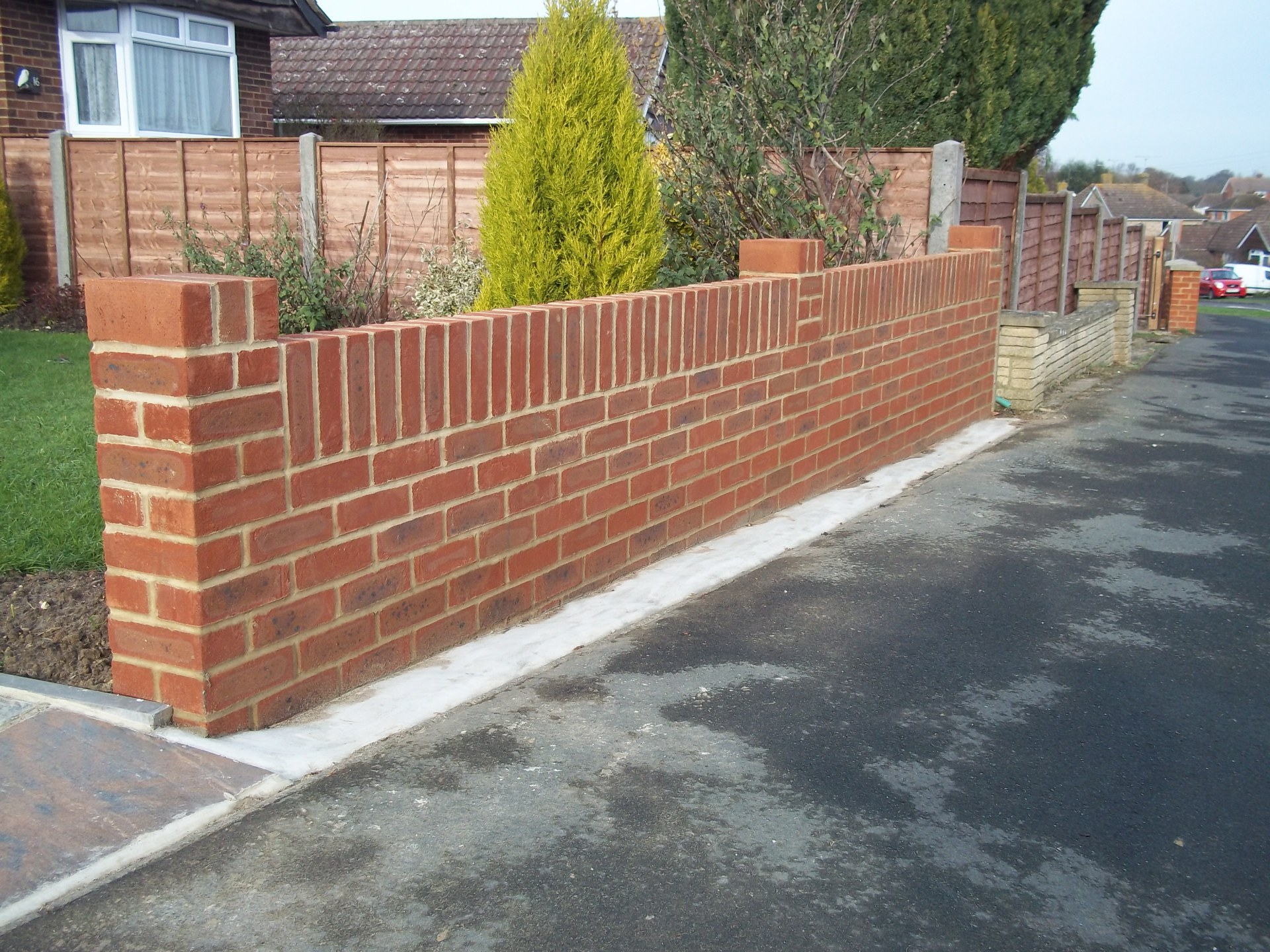 "4"" garden wall capped of with brick soldiers."