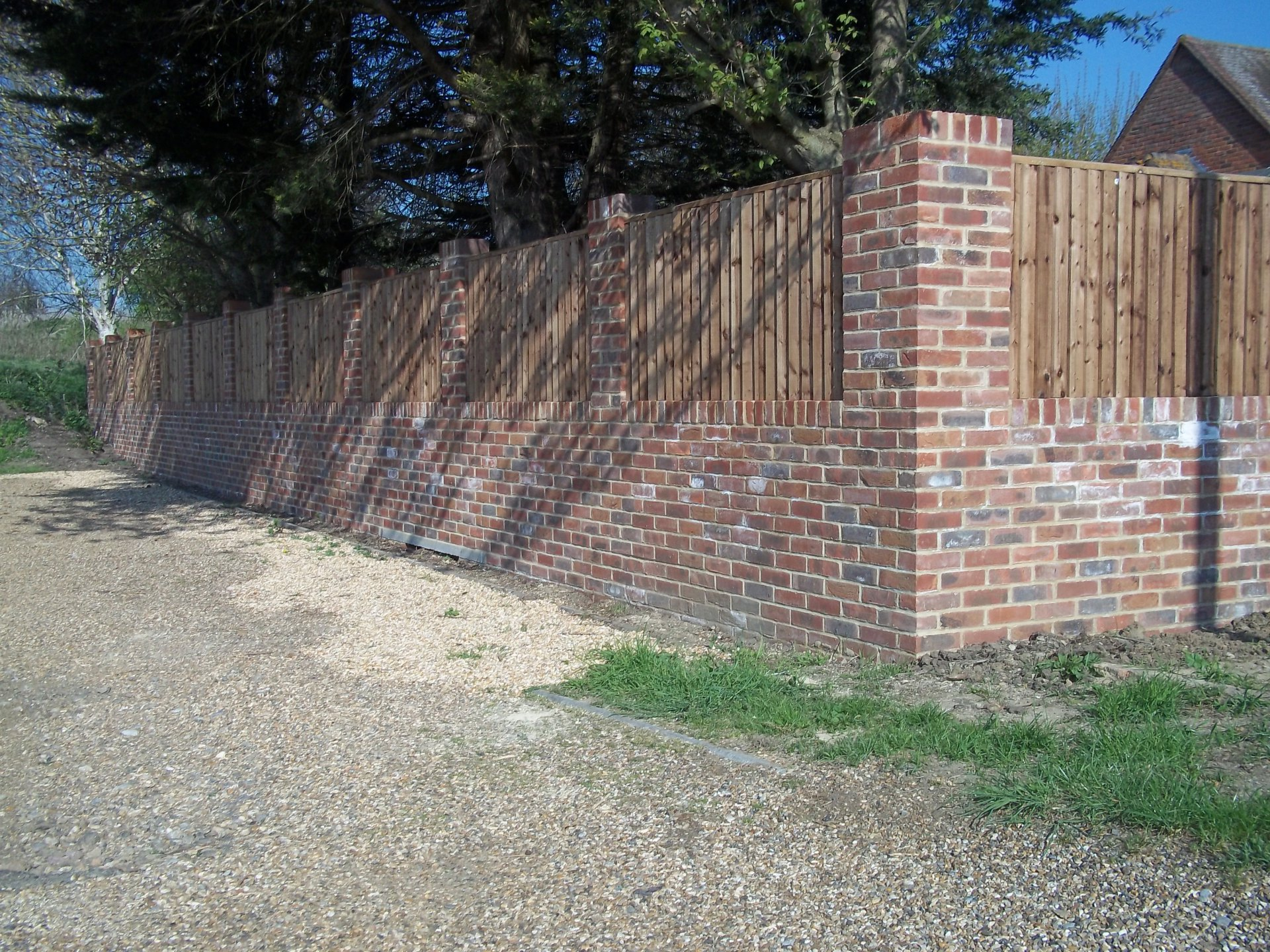 "9"" garden wall with built in fence panels."