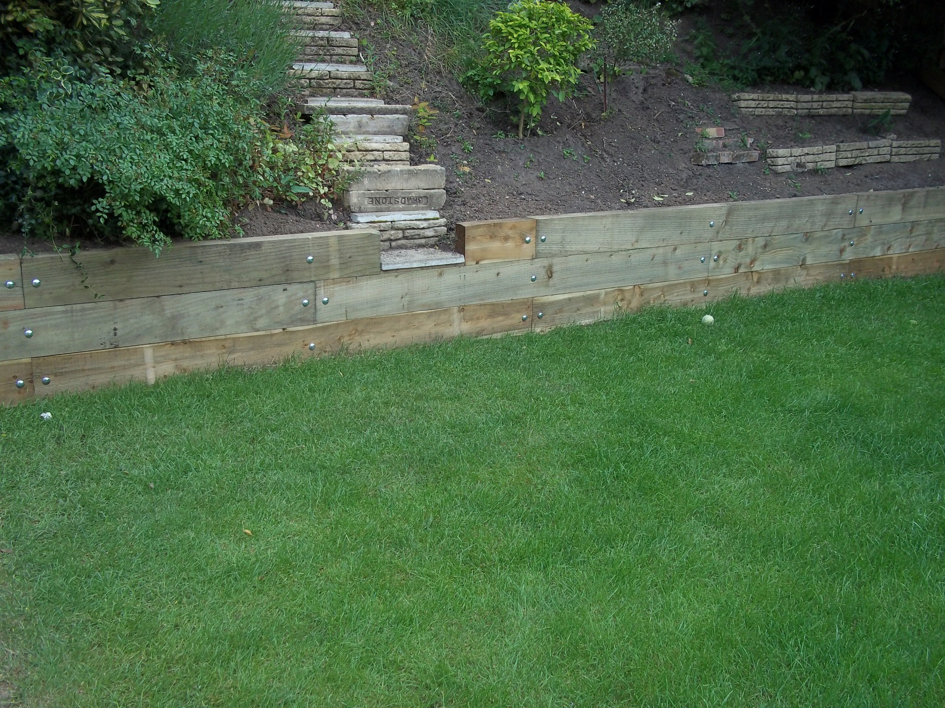 Retaining sleeper wall.