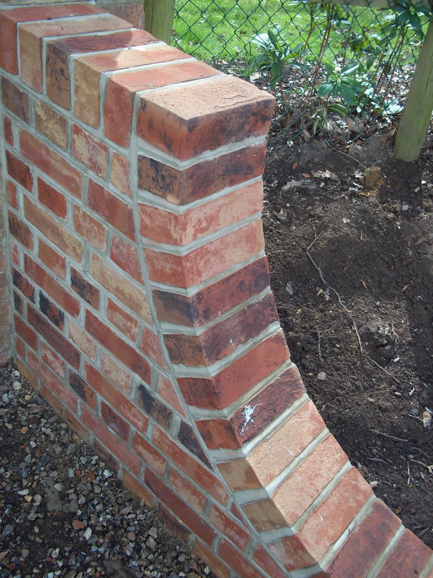 "9"" brick wall with bird beak pointing."