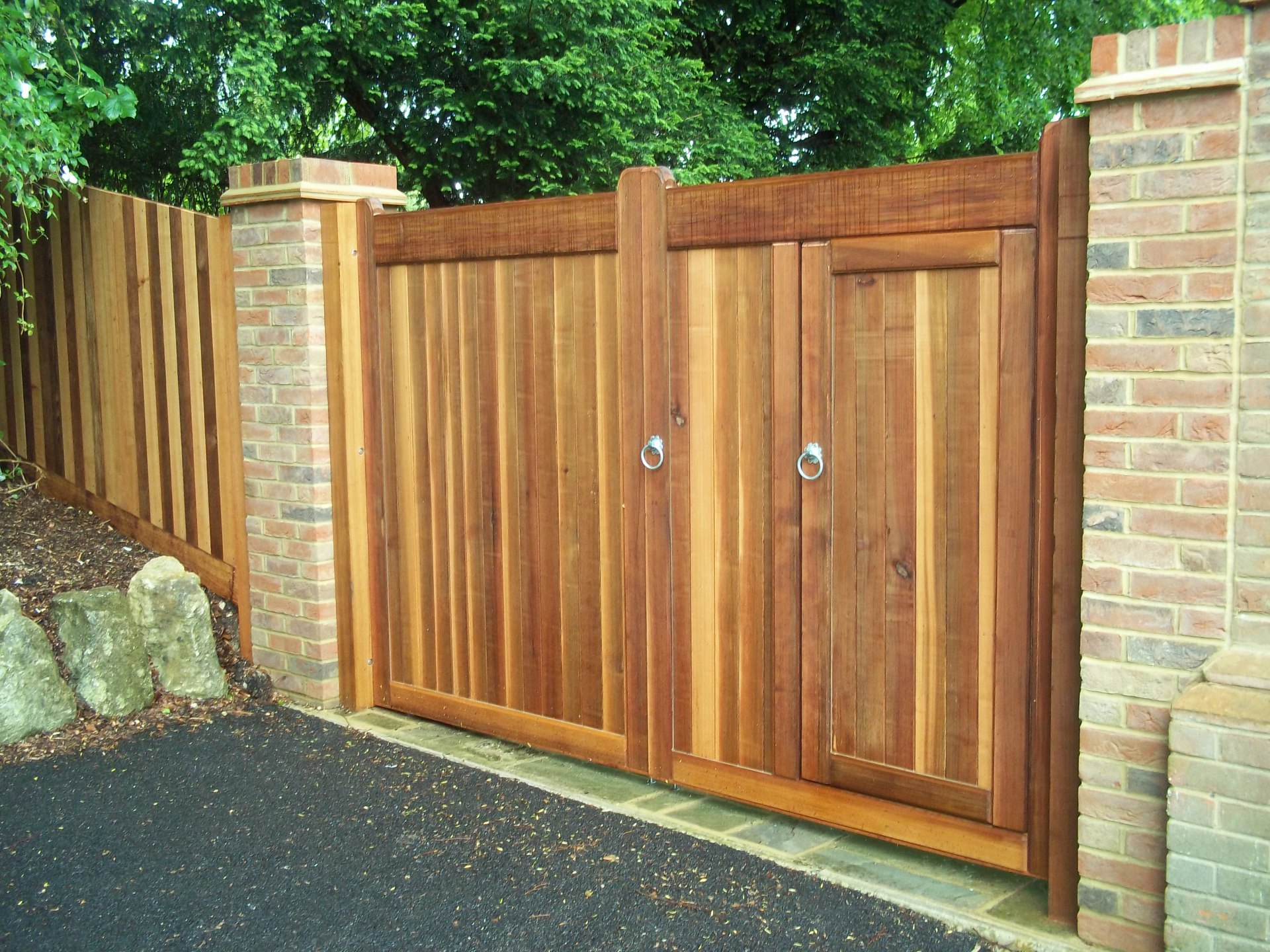 "2 18"" brick piers supporting oak gates & fence."