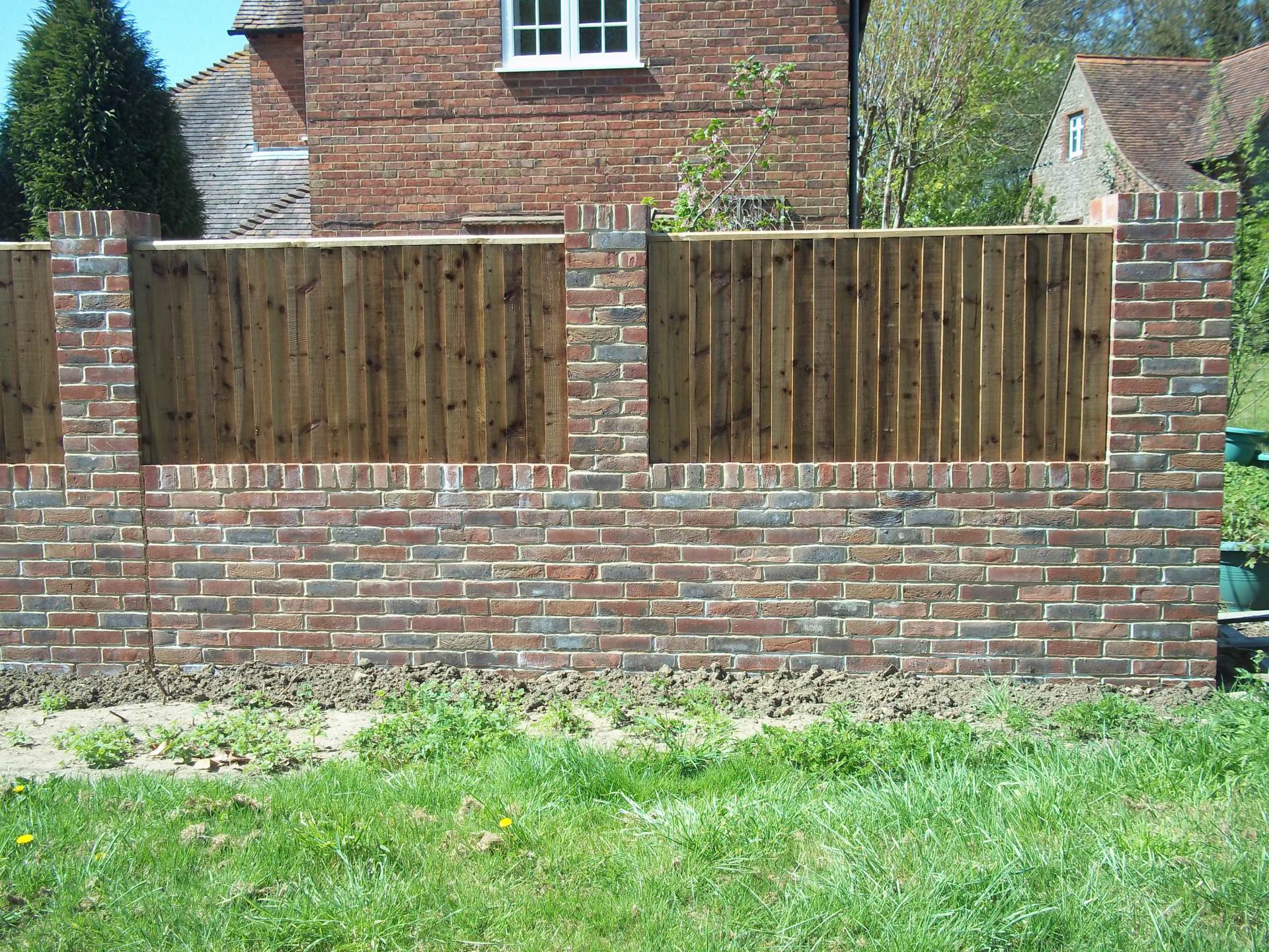 "9"" garden wall with built in fence panels"