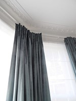 euro pleat velvet curtains in warwick fabric over sheer roman blinds in fulham house