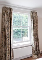 hand pleated curtains in warwick fabric linen in fulham house on cameron fuller pole