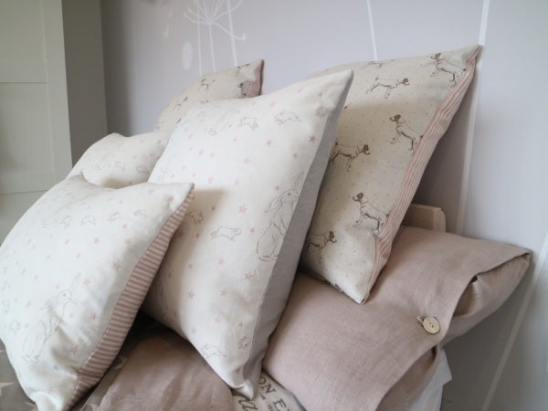 Assorted linen cushions and throw in Thames Ditton