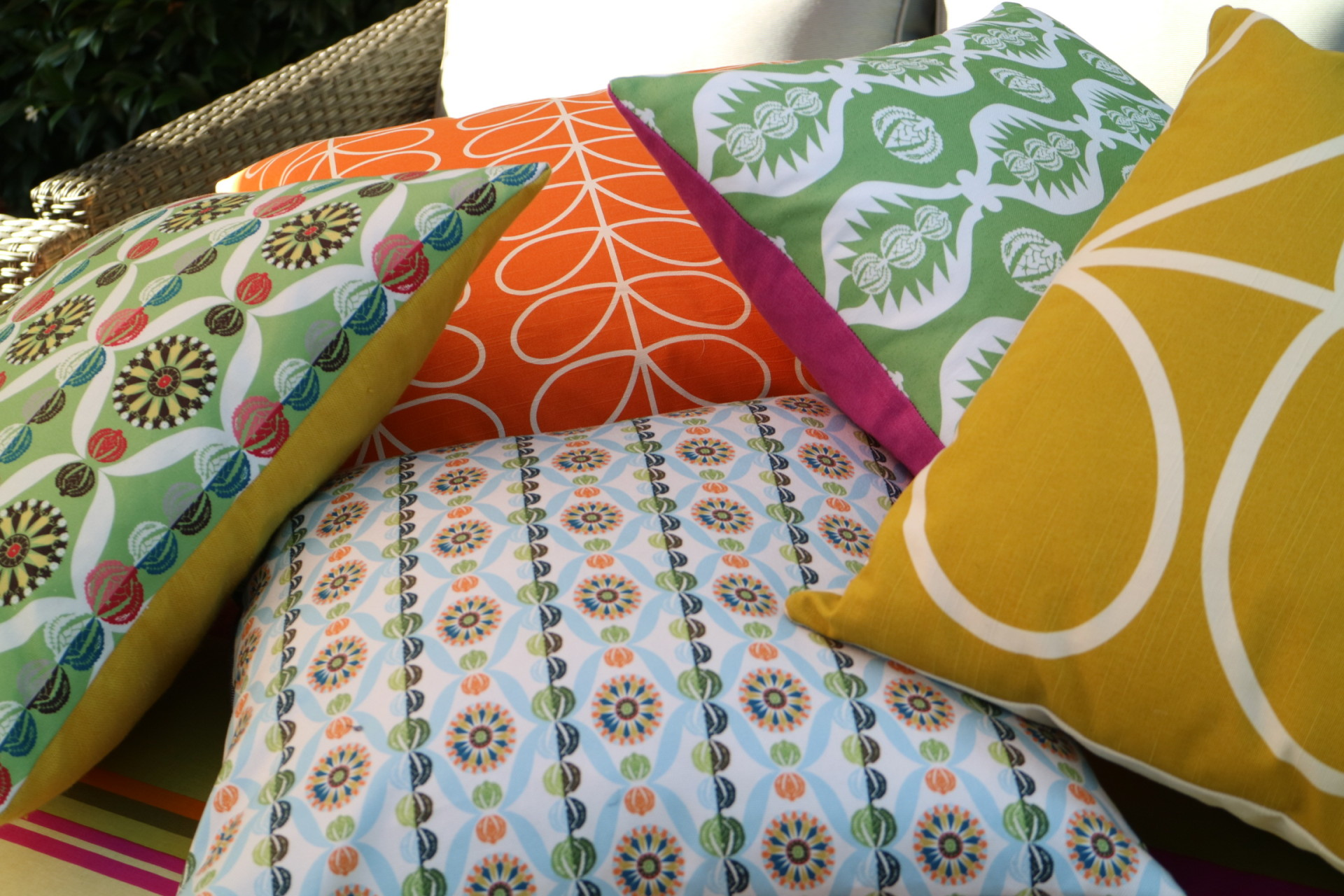 bold coloured bespoke garden cushions in fabrics by charlotte gaisford