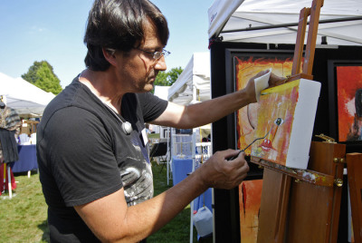 Artist working at show.