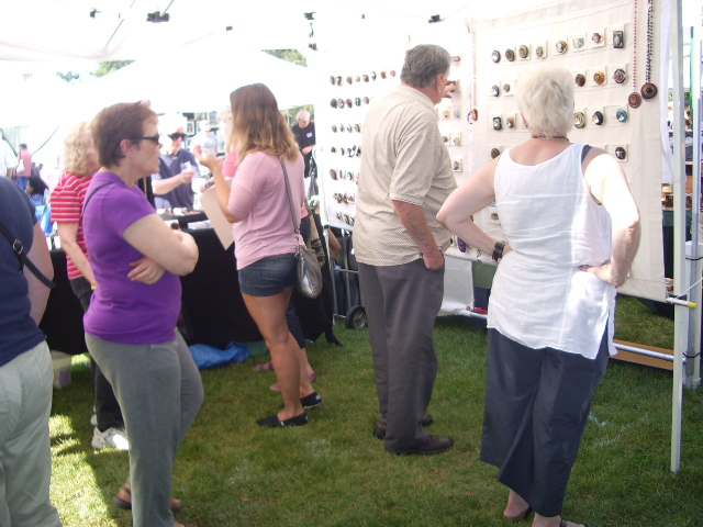 Many Patrons Viewing Artist's Work