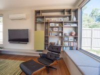 Gray Smith Architect Castlemaine house living room with window seat and wall storage cabinet