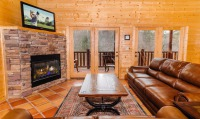 Gas log fireplace and cozy leather furniture