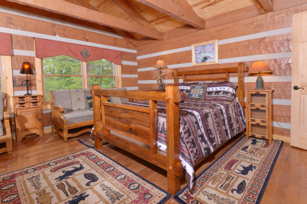 Appalachian Escape Cabin family bedroom with 2 queen beds and 2 twin daybeds