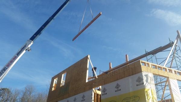Ridge View Lodge - installing main timber frame ridge beam 02.04.17