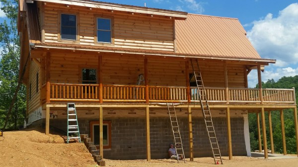 Ridge View Lodge Cabin staining the walls
