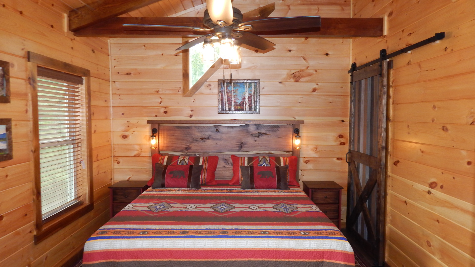 exposed beams construction cabin bedroom