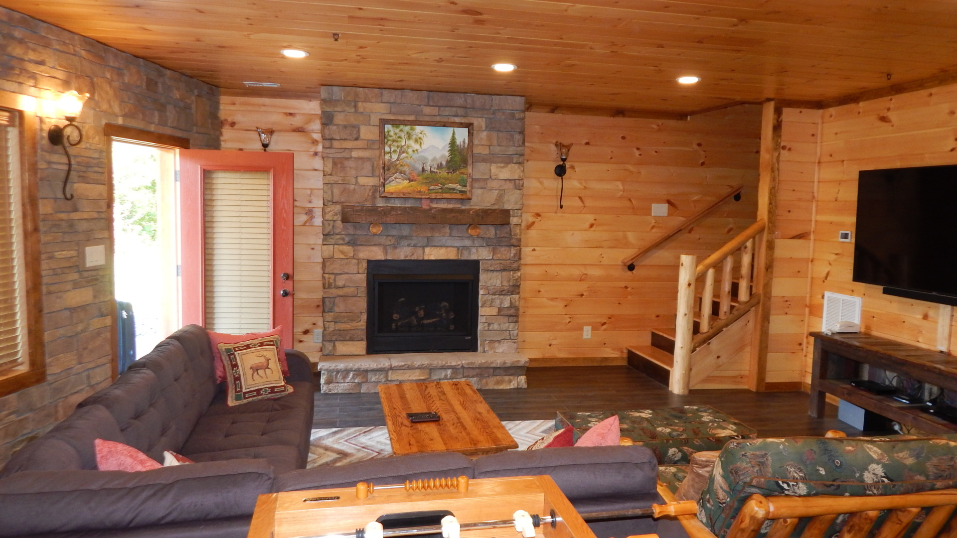 mancave with fireplace in a gatlinburg cabin