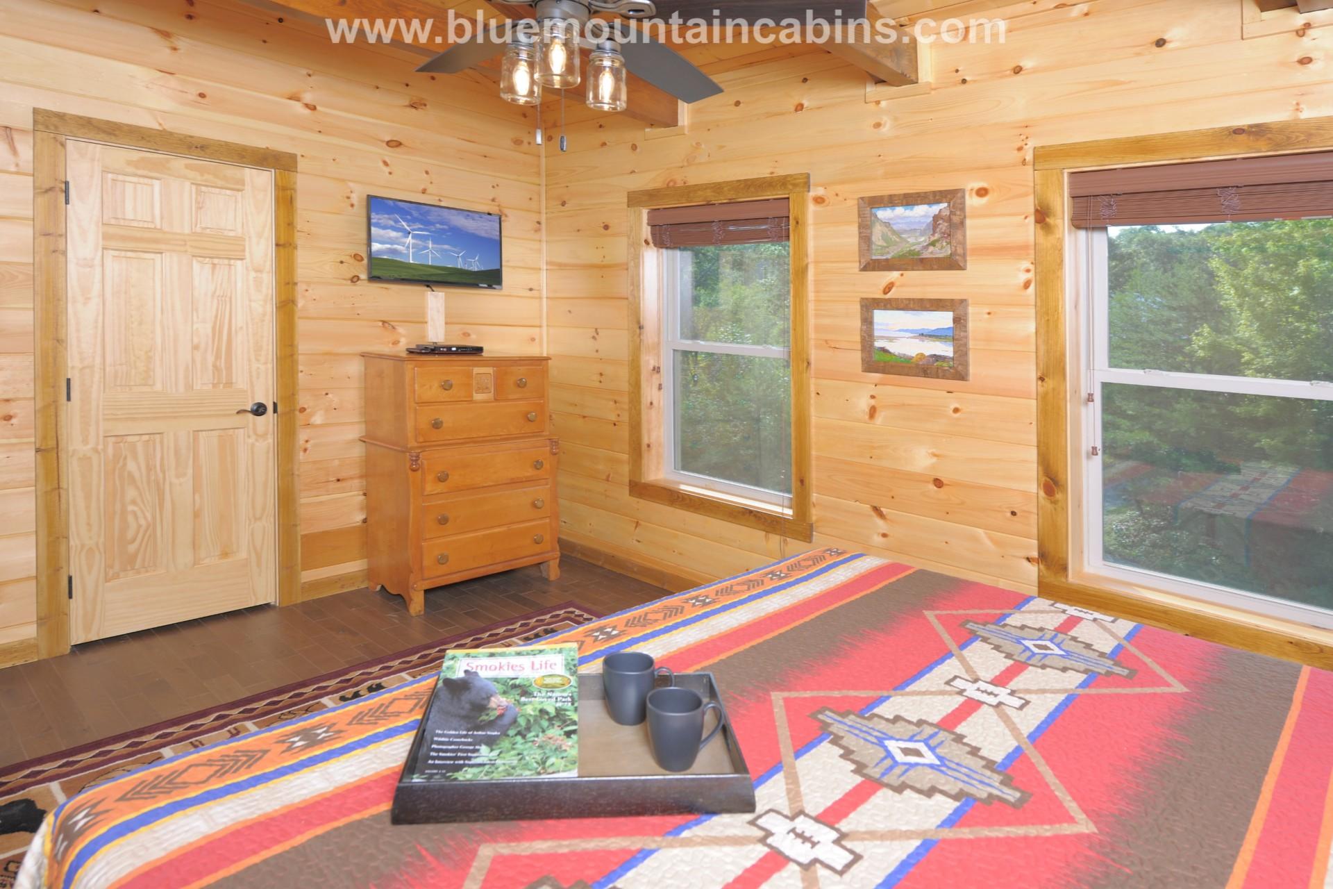 exposed beams construction cabin bedroom