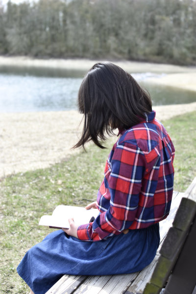 A young lady is reading her Bible.