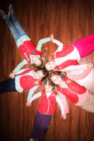 AWANA Girls make a circle of friends shape.