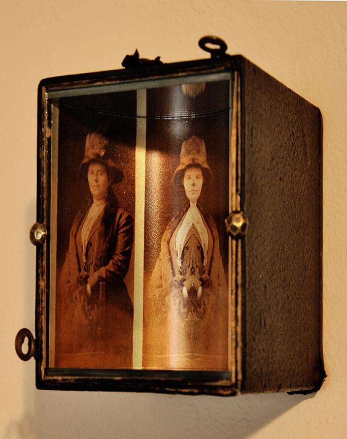 Mirrored portrait in vintage camera body