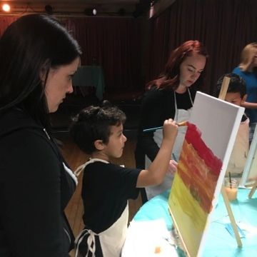 Zayden very focused, making aunty watch.  Paint night fundraiser 11/15