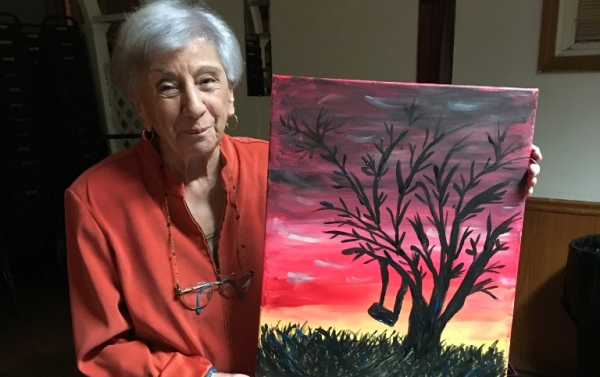 Nana Melisi showing off her painting. Paint night fundraiser 11/15