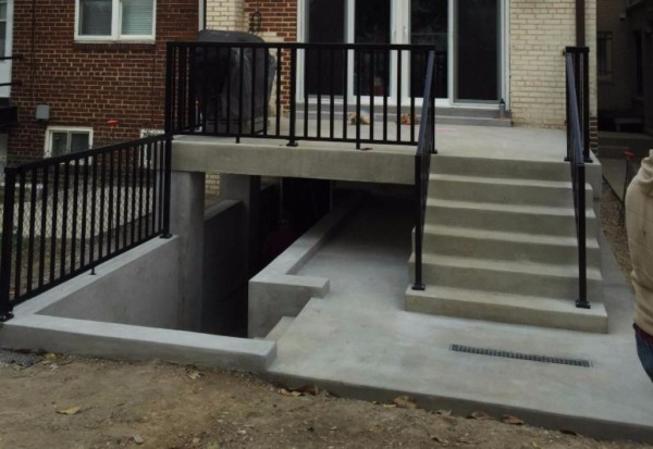 Kingman Park concrete porch deck and stairs.  Excavated all dirt to basement door and installed new concrete porch deck, stairs and railing. Rebuild brickwork, Historic restoration, Re-pointing, Tuck-pointing, emergency repair. Are you looking for a contractor to do work on your historic property in the Washington DC Area? Look no further than Pointing Plus Construction Company LLC. Pointing Plus has been serving the Washington DC area for thirteen years. We specialize in Re-pointing (tuck pointing), rebuilding masonry, concrete work and structural rehabilitation of historic homes.
