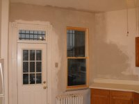 Once we know the repointing outside has stopped moisture from coming in we can start removing the damaged plaster and re- plaster the wall.