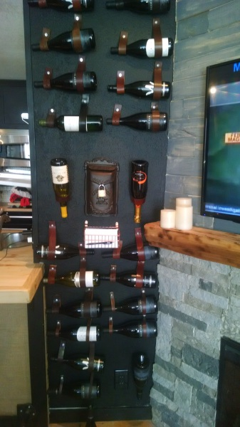 Wall of Wine Made With Old Leather Belts