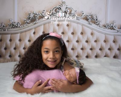 newborn girl and sister charlotte newborn photography