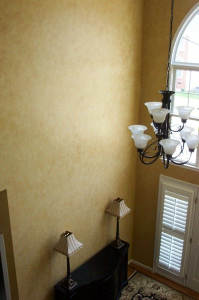 tuscan stone yellow glazed two story foyer faux finish durham decorative painting raleigh