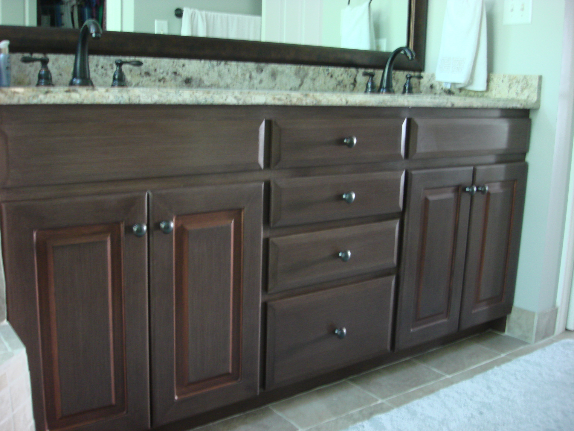 painted glazed brown copper accent master bathroom vanity cabinet  faux finish decorative paint raleigh