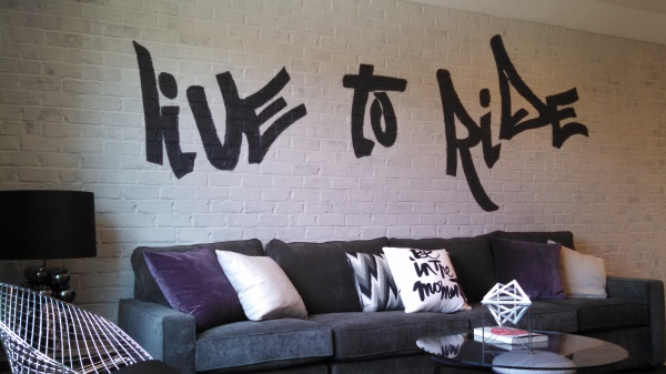 harley davidson man cave, live to ride, grafitti mural, black text, white brick wall