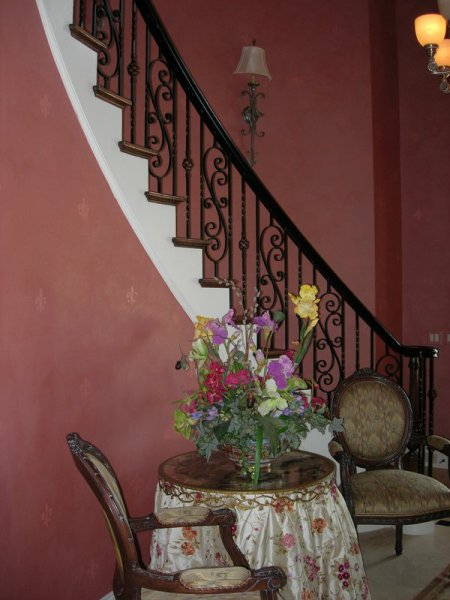 pink mauve sasso perla metallic texture finish with random stamped fleur-di-lis foyer two-story staircase curved faux finish decorative paint raleigh