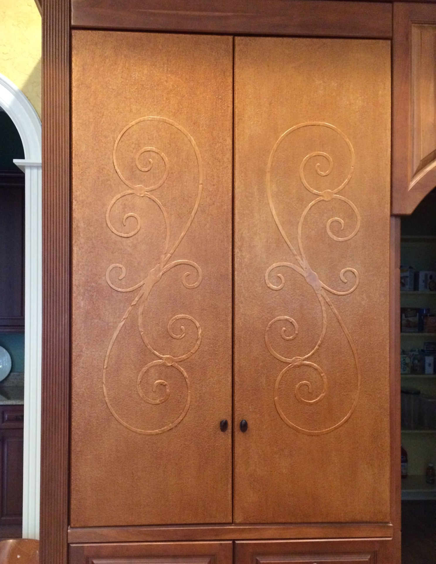copper glazed panty door kitchen with custom raised stencil design wake forest north carolina