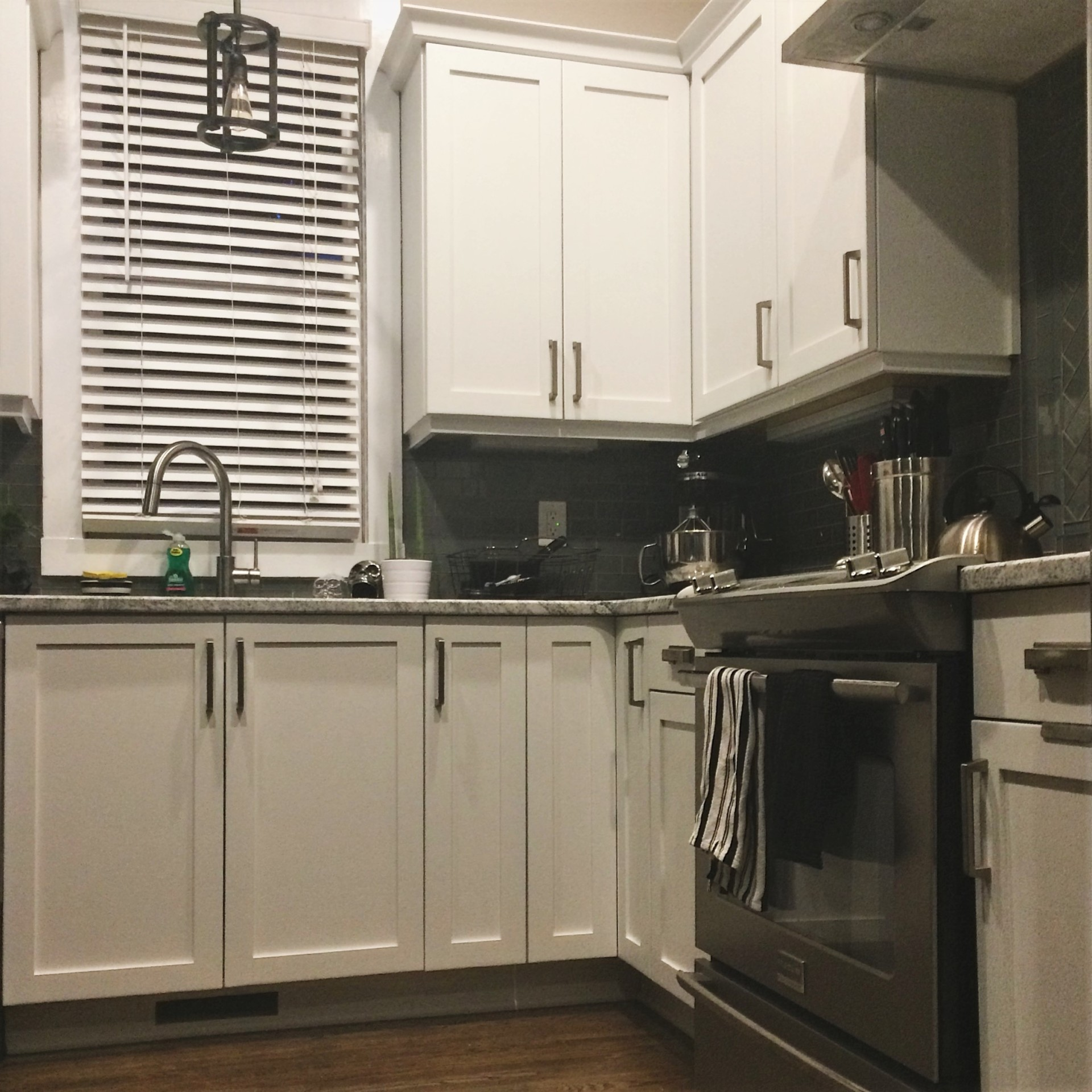 bright white kitchen cabinets custom gray painted island downtown raleigh restoration contemporary