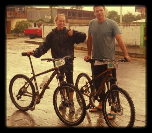 Elsey (Canada) and Dominic (UK) biking in the rain!