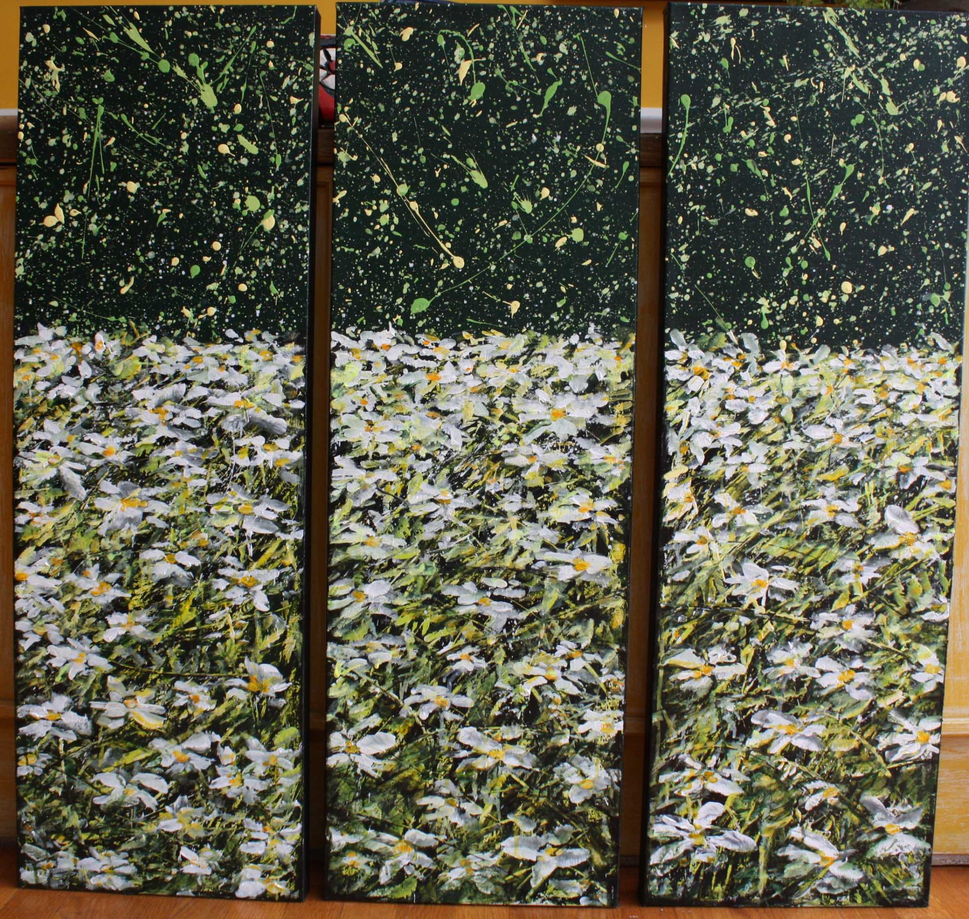 3 panels with daisies