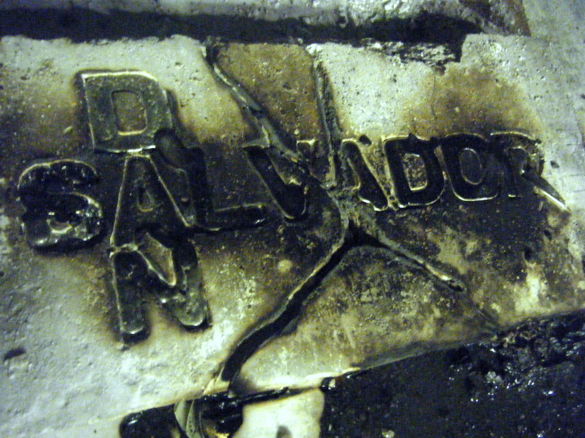 Name on plaster, molten solder and fired