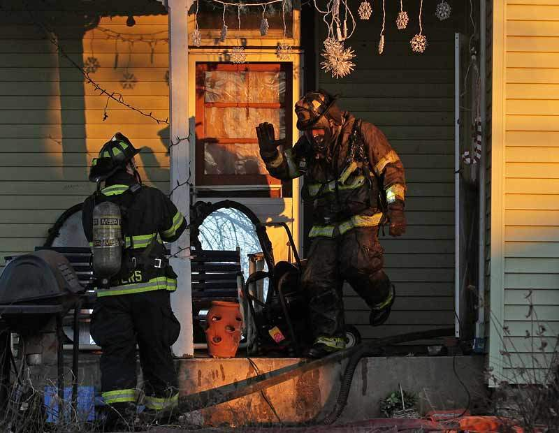 Image of firemen after a residential fire loss