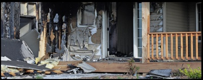 Image of smoke and fire damage to a house