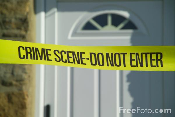 Image of police crime tape text reading crime scene-do not enter
