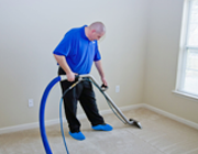 Image of a certified technician using a steam wand for carpet cleaning