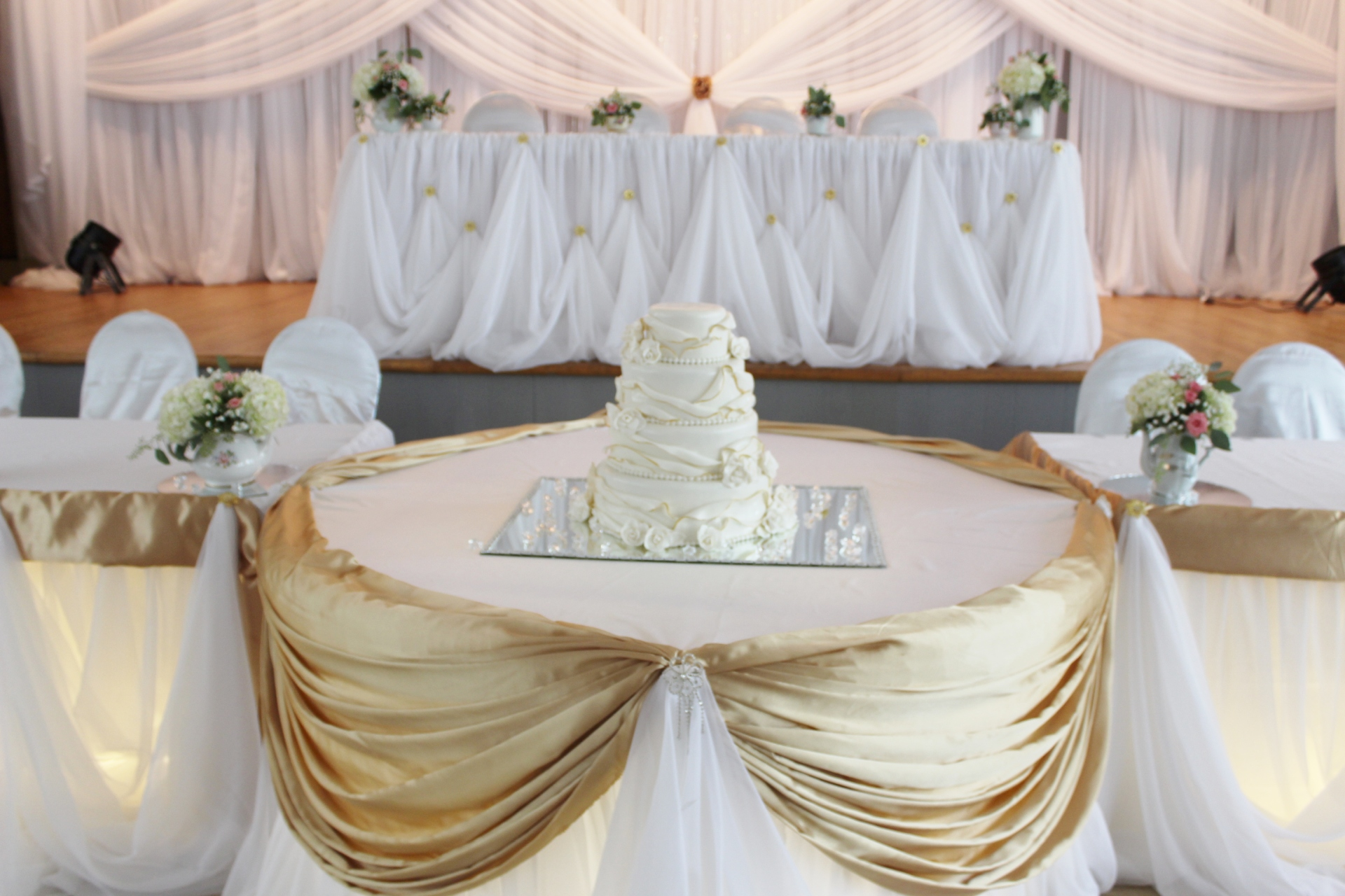 White and gold ruffled wedding
