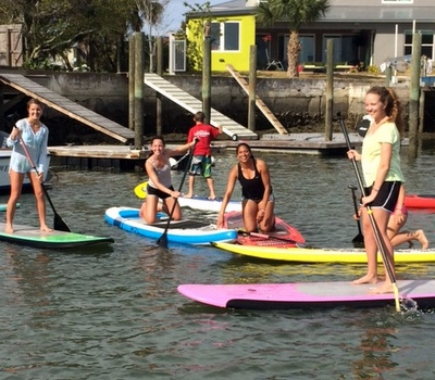 Teenager's having a blast on SUP's for the first time!