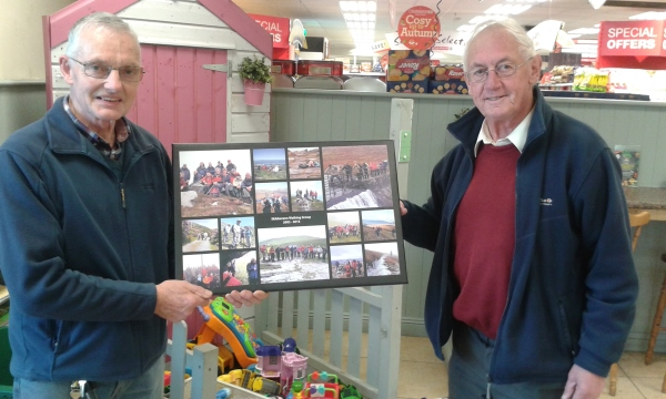Donal O'Donovan presenting collage to Paddy Leahy