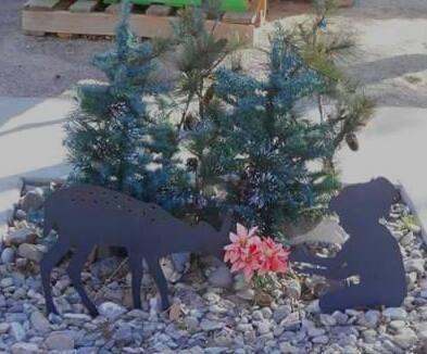 woodland scene with metal deer and girl