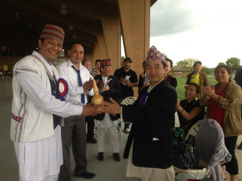 Former president Milan Rai handing over presidency to new president Pravaker Rai. (May, 2013)